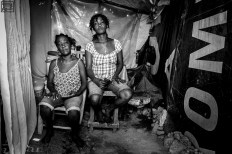 These two sisters had to send their children (7 all together) to friends' house in Croix de Bouquet after the second evacuation. They rely on washing clothes for others for financial support. Photo by Bahare Khodabande, Jan 11 2015, Haiti.