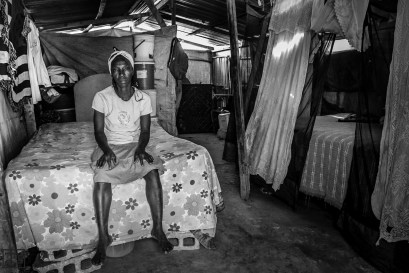 Jorazil, 53, lives with her two children. They share the tent a friend and her three kids (7 residents all together). She sells fried food for money. Photo by Bahare Khodabandeh, Jan 11 2015, Haiti.