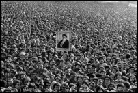 IRAN. Tehran. 1979. Ayatollah Ruhollah KHOMEINI's portrait is exhibited by the crowd attending the opening of the Tehran university. The future President of the Islamic Republic Mahmoud AHMADINEJAD is in the bottom right, behind the man in the fur hat.