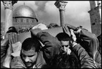 ISRAEL. Jerusalem. 1995. The body of a young Palestinian, slain by an Israeli private guard, is paraded around the Dome of the Rock before being buried.