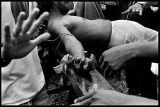 PHILIPPINES. Pampanga district. Village of Santa Lucia. 1995. Crucifixion of a fidel during Good Friday.