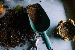 scoop with dirt and pots