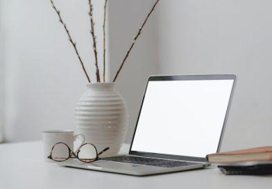 Book Group--white-ceramic-vase-beside-laptop