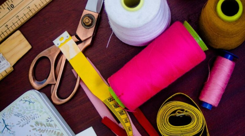 Makers meetup craft supplies on a table scissors, tape, ruler, thread