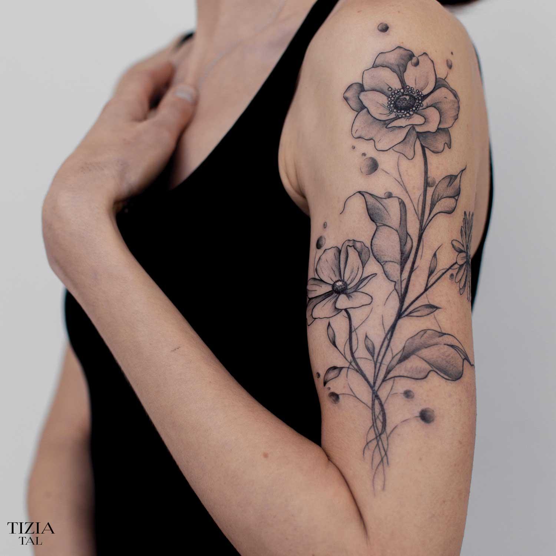 Tattoo-fleur-bras-femme