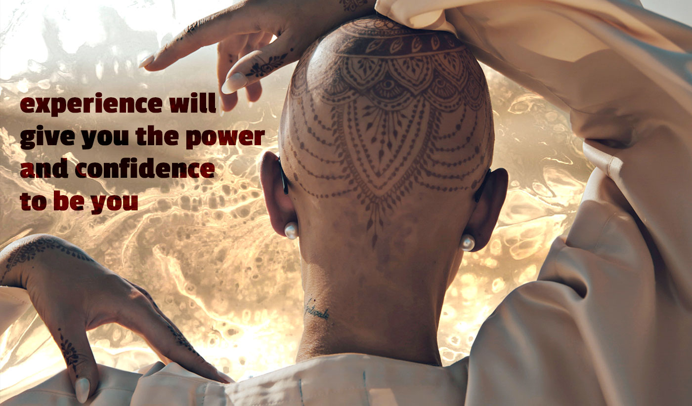 daily inspirational quote image: close up of the back of a person with beautiful Henna Tattoos