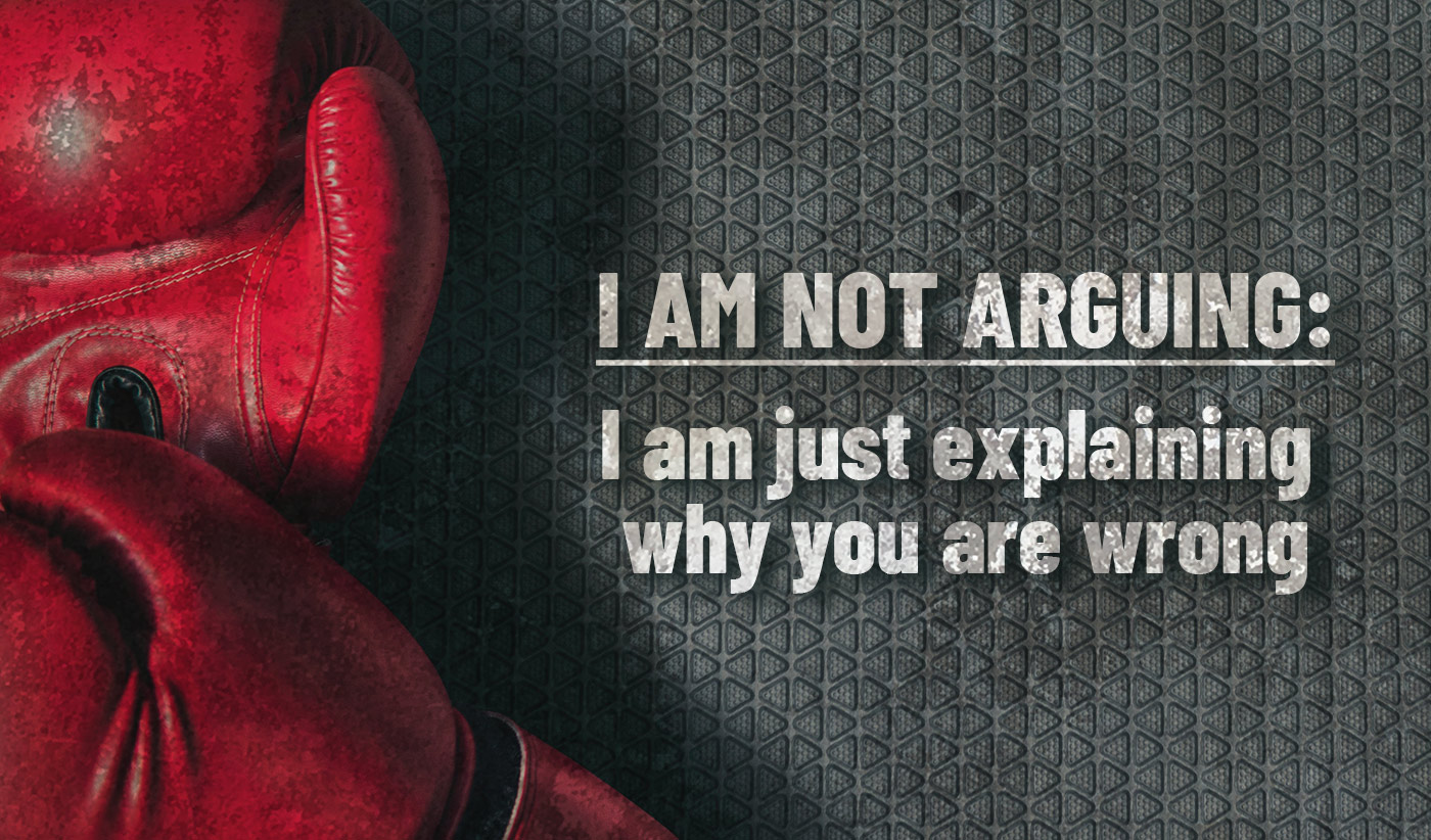 daily inspirational quote image: a pair of red boxing gloves on a gray pavement