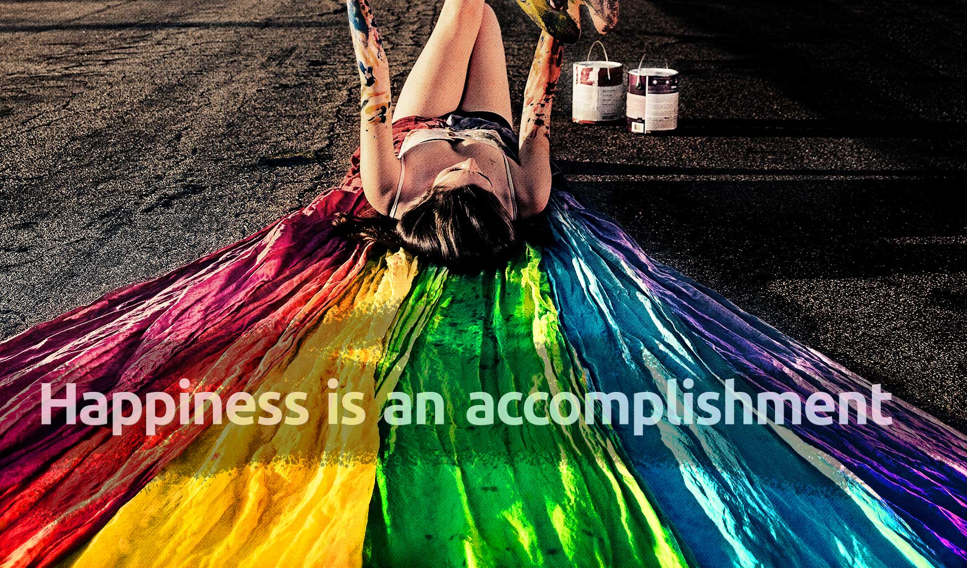 daily inspirational quote image:a woman lying on a rainbow colored banner, with paint on her body
