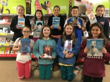 Fifth grade helpers with their favorite book from the fair