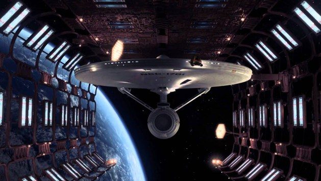 The refitted USS Enterprise is revealed in drydock.