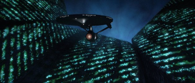 The USS Enterprises cruises over the surface of the alien V'ger.