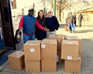 Pictured at 3rd and Girard Ave in Philadelphia with boxes containing 1,916 pairs of new socks for the homeless are (l-r) Clayton Ruley, Director at Prevention Point; Taylor Charest, 2nd year medical student at Sidney Kimmel Medical College & JeffHOPE coordinator; Tom Costello Jr, Chief Sock Person, The Joy of Sox.