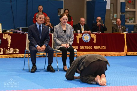 "Grandmaster Sung C. Kim engages in the ""Big Bow"" in respect of his parents"