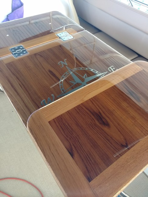 Custom teak table for Sea Ray 400 Fly Bridge buffed with ceramic polish