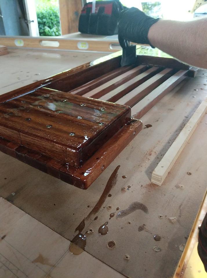 Mahogany trap door for swim platform