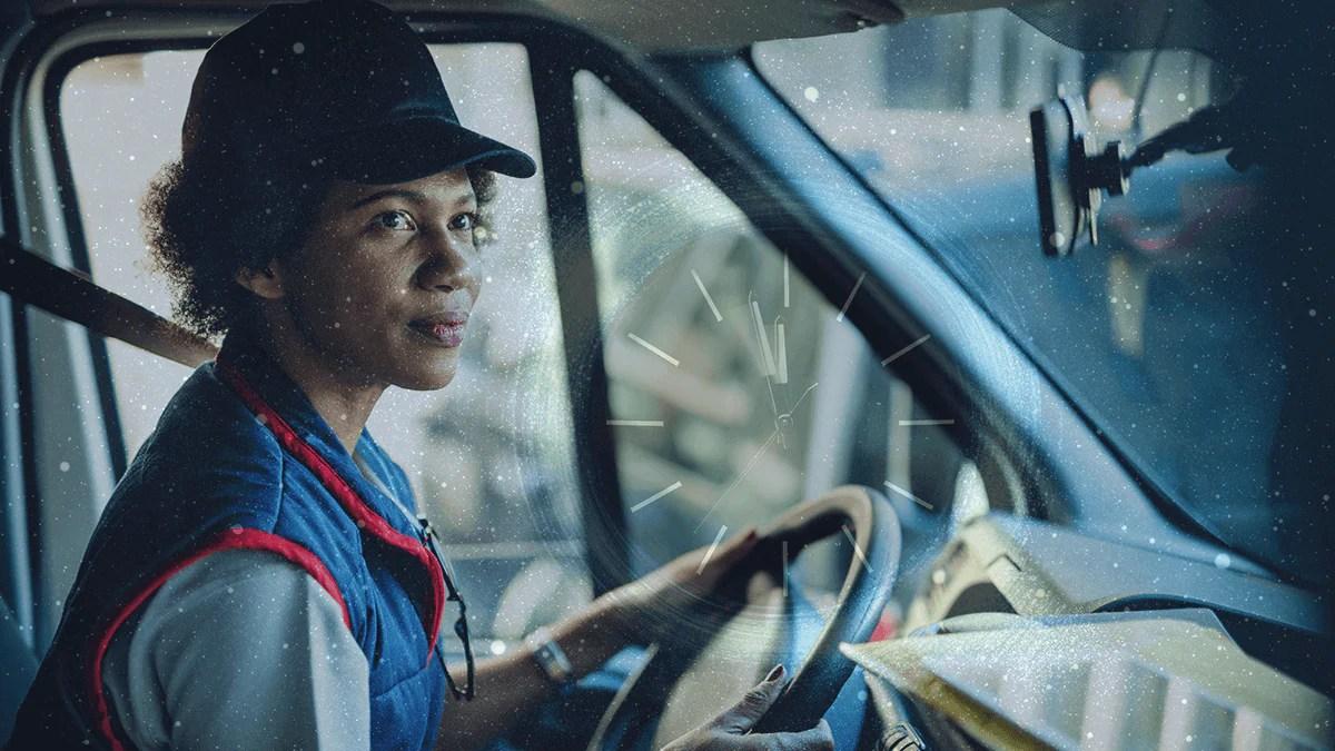 Conductor de camión al volante con cinturón de seguridad