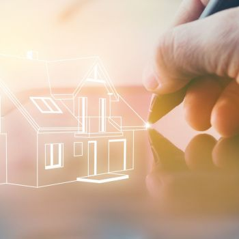 Hand using the latest home design technology to create a virtual house