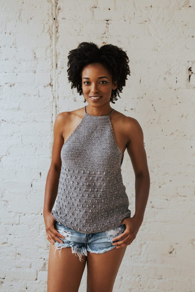 Make the Rebel Cami, a sassy but sweet drawstring halter top crochet pattern from TL Yarn Crafts. Challenge your crochet stills with unique shaping and textured stitches. Pattern available in 2 sizes with plenty of photo tutorials and a helpful chart. Use Lion Brand LB Collection Cotton Jeans for the perfect sleeveless top for summer.