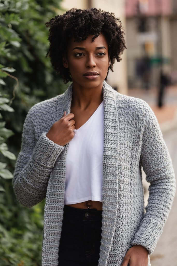The Sweater Weather Cardi, a FREE pattern from TLYCBlog in collaboration with JOANN Stores, is the first cardigan you'll reach for all winter! Made with comfortable worsted weight yarn in your favorite color, this casual layering sweater is chic, modern, and casual at the same time. Wear it to the office, school dropoff, or those late night Target runs - it's perfect for any ocassion! -- The Sweater Weather Cardi is a FREE crochet pattern featuring step by step instructions and is available in sizes small up to extra large. Start now by visiting TLYCBlog.com!