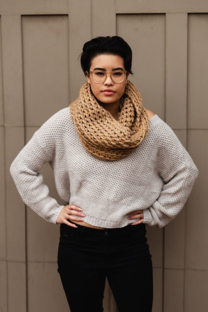 Try the Toasted Marshmallow Infinity, a cozy crochet loop scarf that's ready in less than an hour. Made with super bulky yarn and a large Q hook, this is the perfect scarf to sell at craft markets, gift for the Christmas and birthdays, and to make if you need an extra layer in the winter time. Try this FREE pattern today - find the pattern on TLYCBlog.com and follow the tutorial on YouTube. | TLYCBlog.com