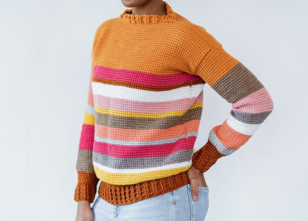 The Sedona Sweater - Free Tunisian crochet sweater pattern, beginner-friendly made with yarn from stash, leftover yarn, or any color yarn. Customize crochet sweater pattern, color block with stripes, ribbed cuffs and collar. TLYCBlog.com