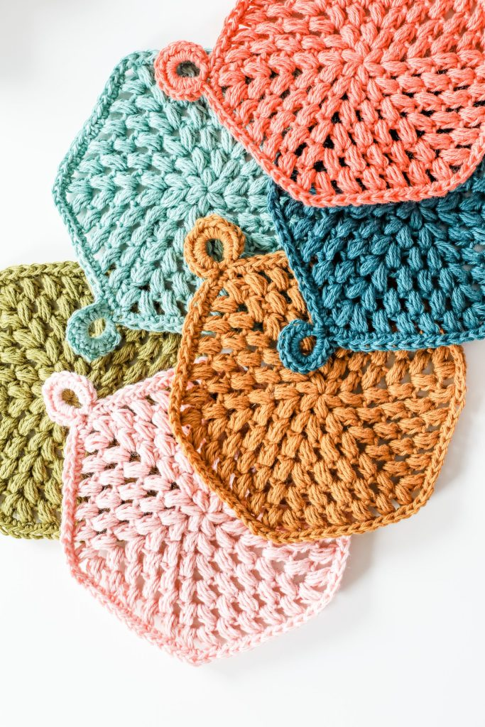 Make the Hexi Puff Coasters, free crochet pattern puff stitch hexagon shaped coasters. Beginner friendly crochet project with tutorial video and one-page printable. | TLYCBlog.com