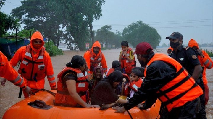 India monsoon: Rescuers search for survivors after heavy rains