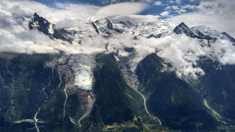 The Mont Blanc massif covered in glaciers and seen from stage 11 on the TMB