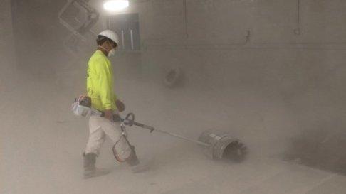 TMI Coatings Cleans Abrasive After Sandblasting Arena