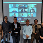 Members of the ANU research team standing in front of a screen where members of the Friedrich Schiller University, Jena, team are projected