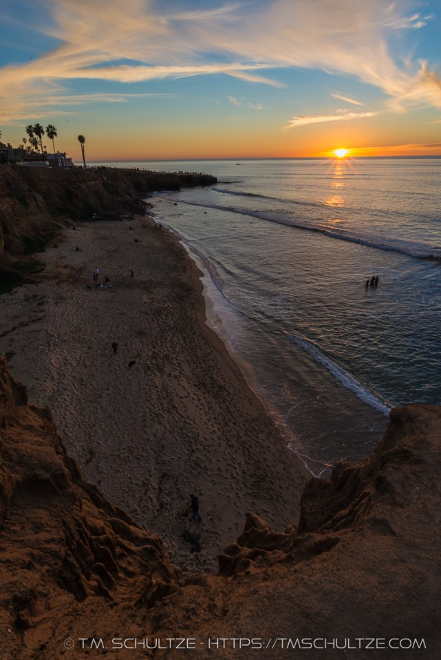 No Surf Beach With Setting Sun by T.M. Schultze