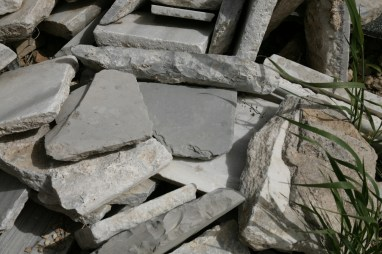 Fig 6. A stack of flooring tiles with some black bituminous limestone tiles that were used to pave the open courts of the Temple Mount during the Second Temple period. (photo: Zachi Dvira)