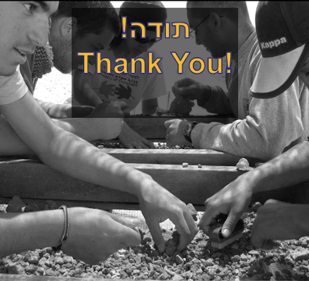 """""""Thank you"""" on background of volunteers sifting"""