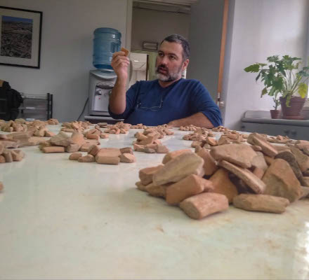 Haggai sorting pottery in the lab