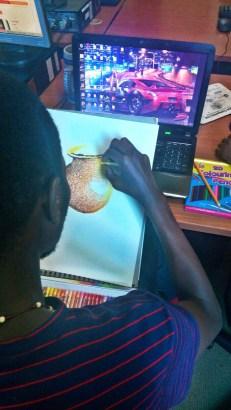 Brian Kawesa at work