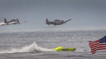 The solo pilots from the GEICO Skytypers Air Show Team compete in a sea vs sky duel against the 11 time world champion Miss GEICO catamaran.