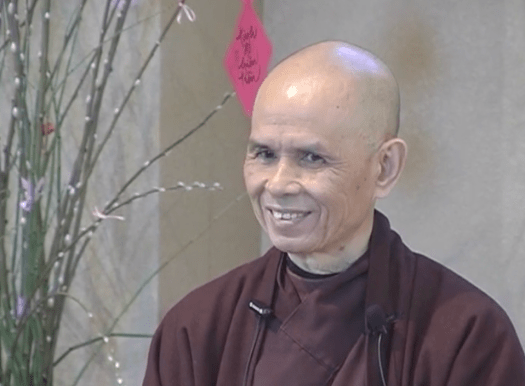 Thich Nhat Hanh smiling during his teaching.