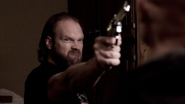 Michael (Tyler Mane) confronts William (Derek Mears) after prying the handgun away from his nephew in 'Compound Fracture'