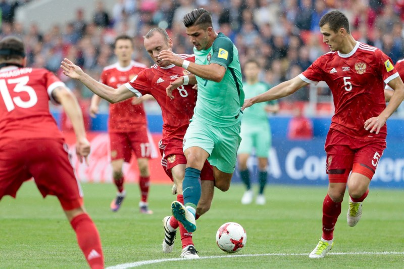 Portugals Andre Silva Is Challenged By Russias Denis Glushakov During The Confederations Cup Group A Soccer Match Between Russia And