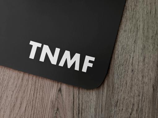 T N M F sticker on a black mudflap