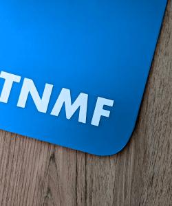T N M F sticker on a blue mudflap