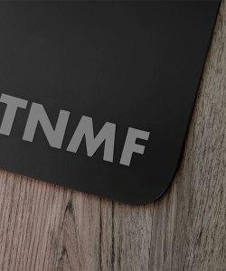 T N M F gray sticker on a black mudflap