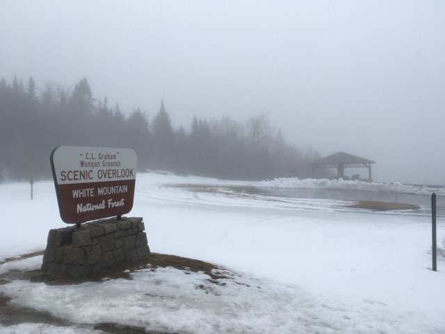 A scenic overlook sign in the White Mountains. It is foggy and raining and hence not so scenic.