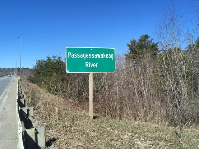 A road sign announcing the Passagawakeag River.