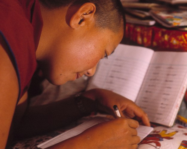 Buddhist Nun Studying in Room