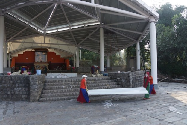 Tibetan Buddhist nuns at Dolma Ling working to build the new roof for the debate courtyard. Tibetan Nuns Project
