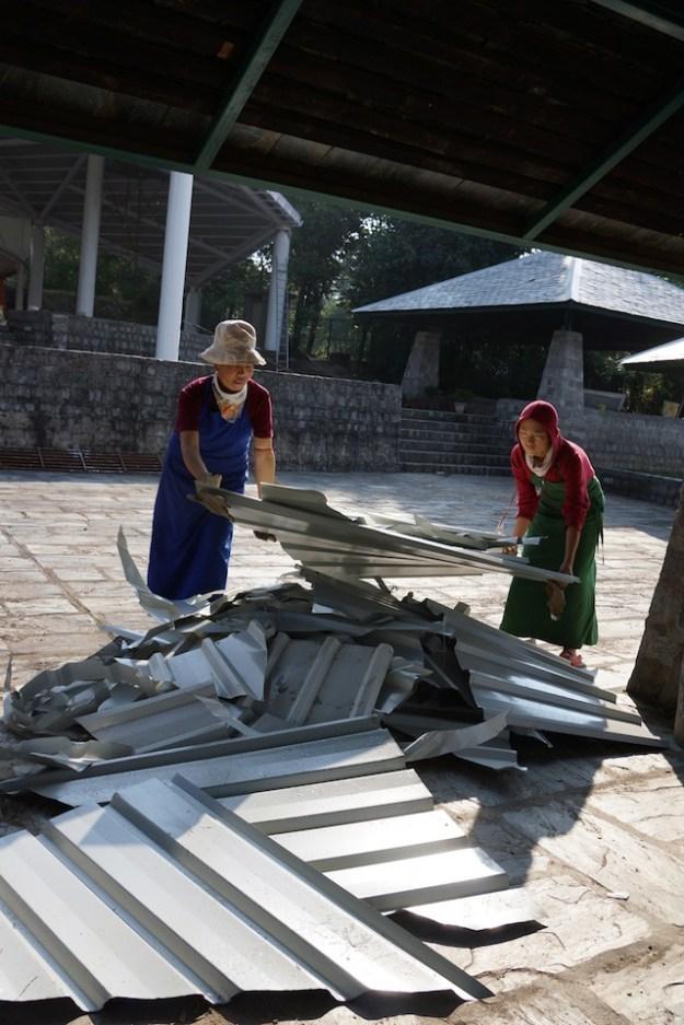 nuns working on metal roof debate courtyard Tibetan Nuns Project