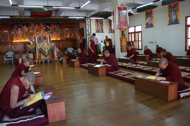 Tibetan Buddhist nuns sitting round 2 of Geshema exams