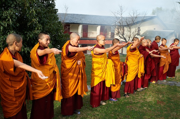 Buddhist nuns throwing tsampa at Losar