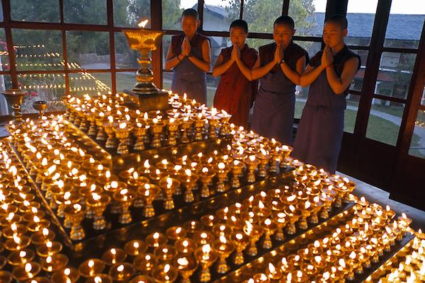 Buddhist nuns saying prayers
